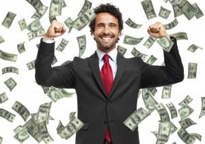 Happy-man-enjoying-the-rain-of-money-000042196558_Medium