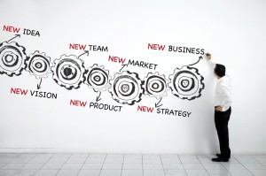 Man-drawing-business-plan-made-of-gears-000027686055_Medium