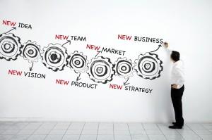 Man-drawing-business-plan-made-of-gears-000027686055_Medium